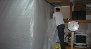 Technician Installing Vapor Barrier To Remediate Mold